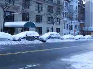 Vehicles on West End Avenue manageably plowed in.