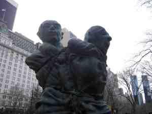 Two more miserable bronze dudes.
