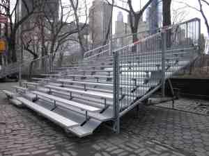 Metal stands hogging sidewalk.