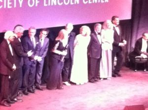 Barbra in center on stage at event's close.