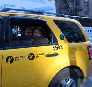 Jubilant Kathy and Sara in taxi heading toward the next leg in their life together.