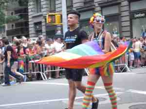 Boy marching with Rainbow Girl.