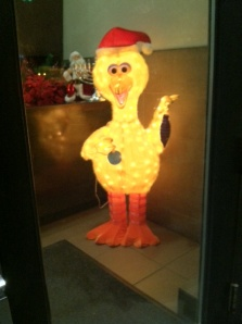 Big Bird multitasking as holiday eyesore.