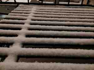 Fluffy snow on fire escape.
