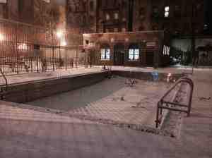 Vesuvio playground swimming pool missing summer sun.