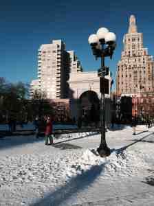 Washington Square Park under vibrant blue arctic cold sky.
