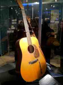 Elvis's guitar. The Beatles were big fans of his, but he was in no hurry to meet them.