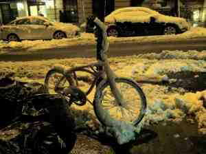 Frozen bike with missing seat; maybe it's warming up indoors?