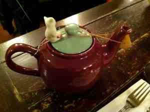 My tea pot with little cat stopper standing guard over high octane tea.