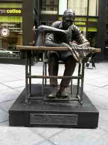 "Bronze statue called ""The Garment Worker"" a relic to the era before  garments were made overseas."