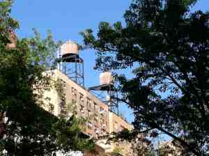 Upper West Side water towers looking good against a clear blue sky.