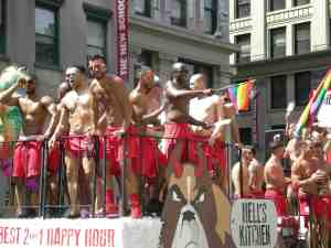 Guys in red boxers gyrating on float.