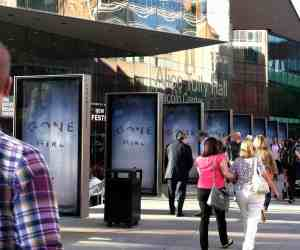 Outside Lincoln Center's Alice Tully Hall, eight posters promoting Gone Girl, rubbing it into the eyeballs for anyone without tickets.