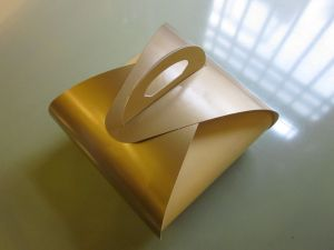 Gold tulip box containing our Cronuts.