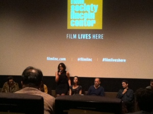 Desiree Akhavan standing as she fields audience questions.