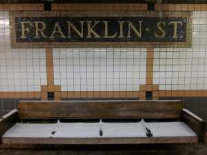 Lower Manhattan subway stop; not the best day to bench sit.