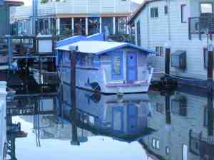 Tim Burton-esqe style houseboat from behind.