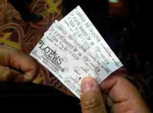 Milton holding our tickets.