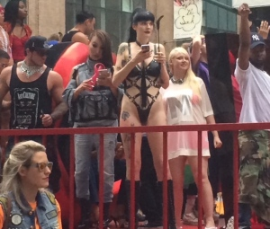 Dominatrix with cellphone pride.