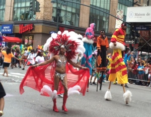 What you see is what you get: red headdress and stilt walkers.