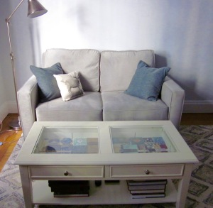 Yes, the shadow box coffee table is full of tiles.